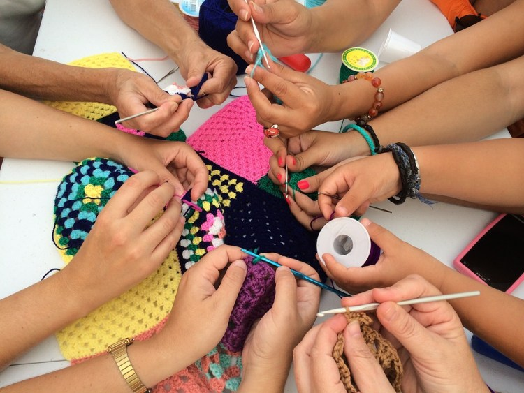women-crocheting-together