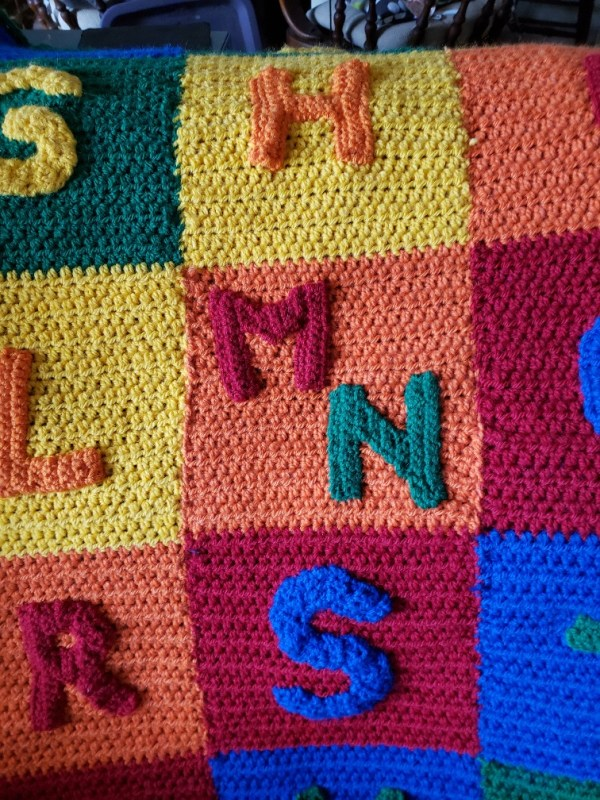 baby blanket closeup of M,N to fit into color block