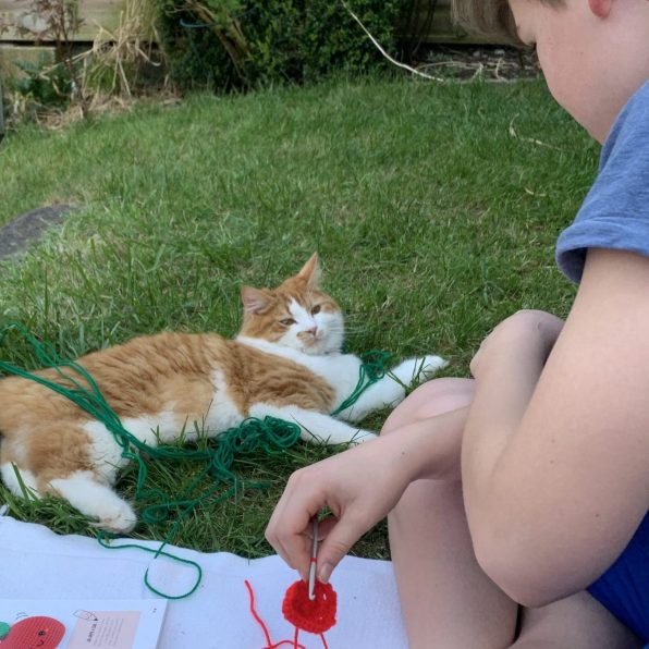 Benji helping with the crochet