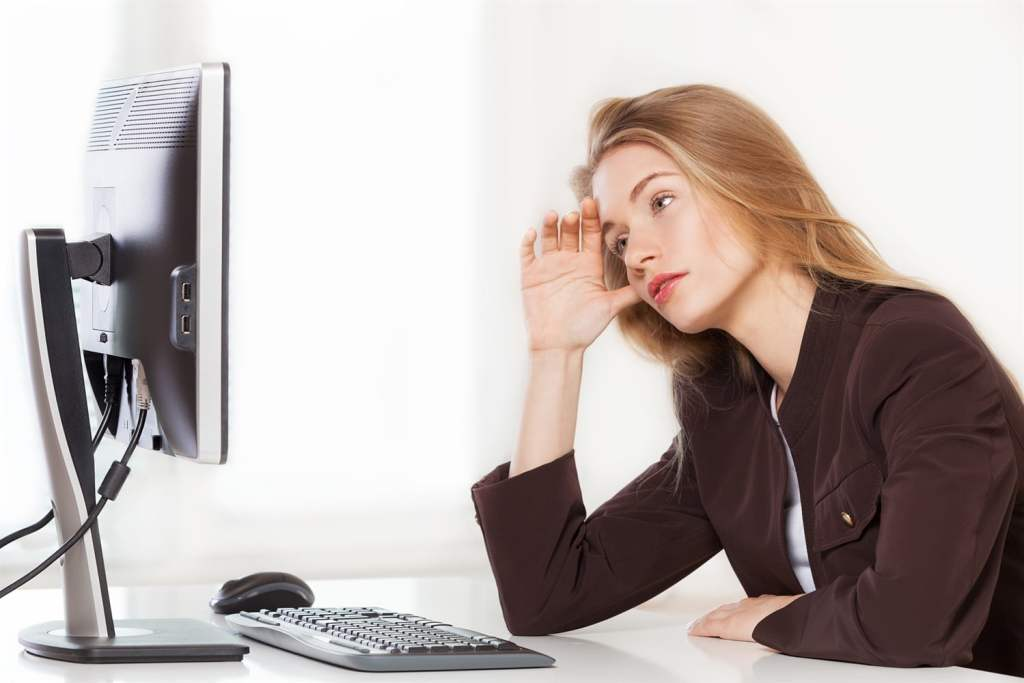woman business owner staring at computer in confusion