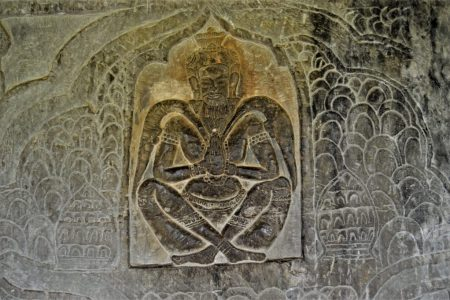 Brahma sitting in a cocoon in the Battle between Gods and Asuras bas-relief carved in the lower-level gallery of the Angkor Wat Temple
