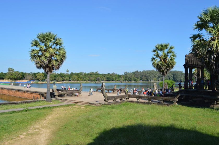 Moat and the causeway at the entrance to the outer enclosure of the Angkor Wat complex in Siem Reap, Cambodia