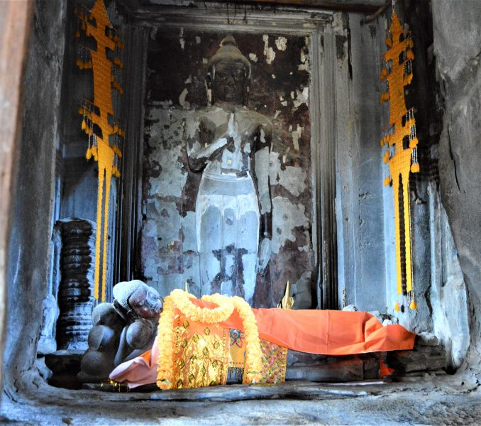 A statue of sleeping Buddha on the uppermost terrace of the Angkor Wat Temple in Siem Reap, Cambodia