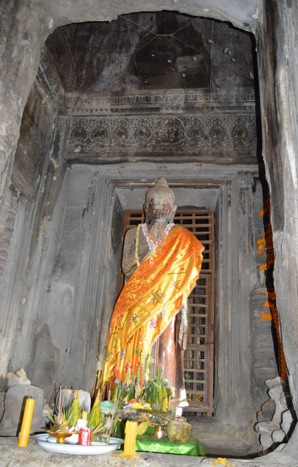 A statue of Buddha on the uppermost terrace of the Angkor Wat Temple in Siem Reao, Cambodia
