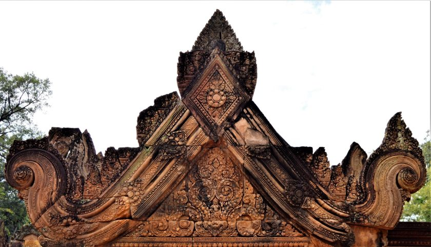 A beautifully decorated pediment of the east gopura of the middle enclosure with a bas-relief depicting time monster Kaala.