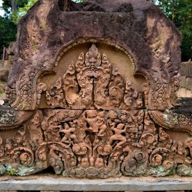 Ravana abducting Sita, an episode from Ramayana depicted on the east-facing pediment of the eastern gopura on the outer enclosure of the Banteay Srei temple