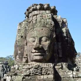 A tower on the upper level of the Bayon Temple carved with smiling faces