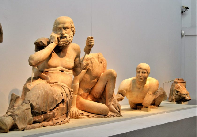 Statues of an old seer and two spectators originally mounted on the eastern pediment of Temple of Zeus