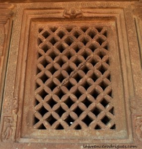 Jālandhara with rhombus patterns installed in a wall surrounding the sabhamantapa and garbhagriha of the Durga Temple at Aihole, Karnataka, India