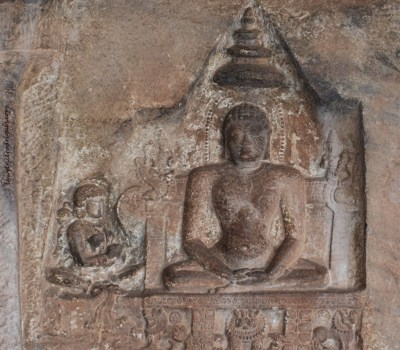 Sculptural relief of Lady Jakkave with Mahavira carved near the entrance of Cave - 4, the fourth of the rock-cut caves located in Badami, Karnataka, India