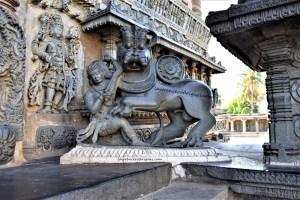 Hoysala emblem on the right-side of the main entrance of the Chennakeshava Temple in Belur, Karnataka, India