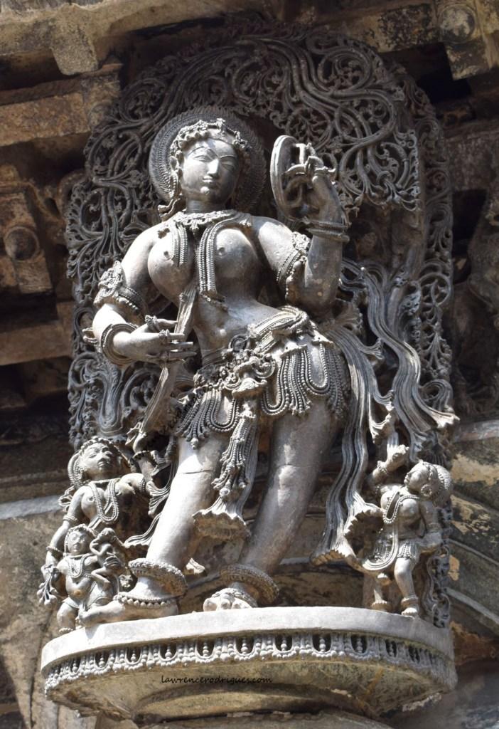 Darpana Sundari - A bracket figure mounted on a pillar at the main entrance of the Chennakeshava Temple in Belur, Karnataka