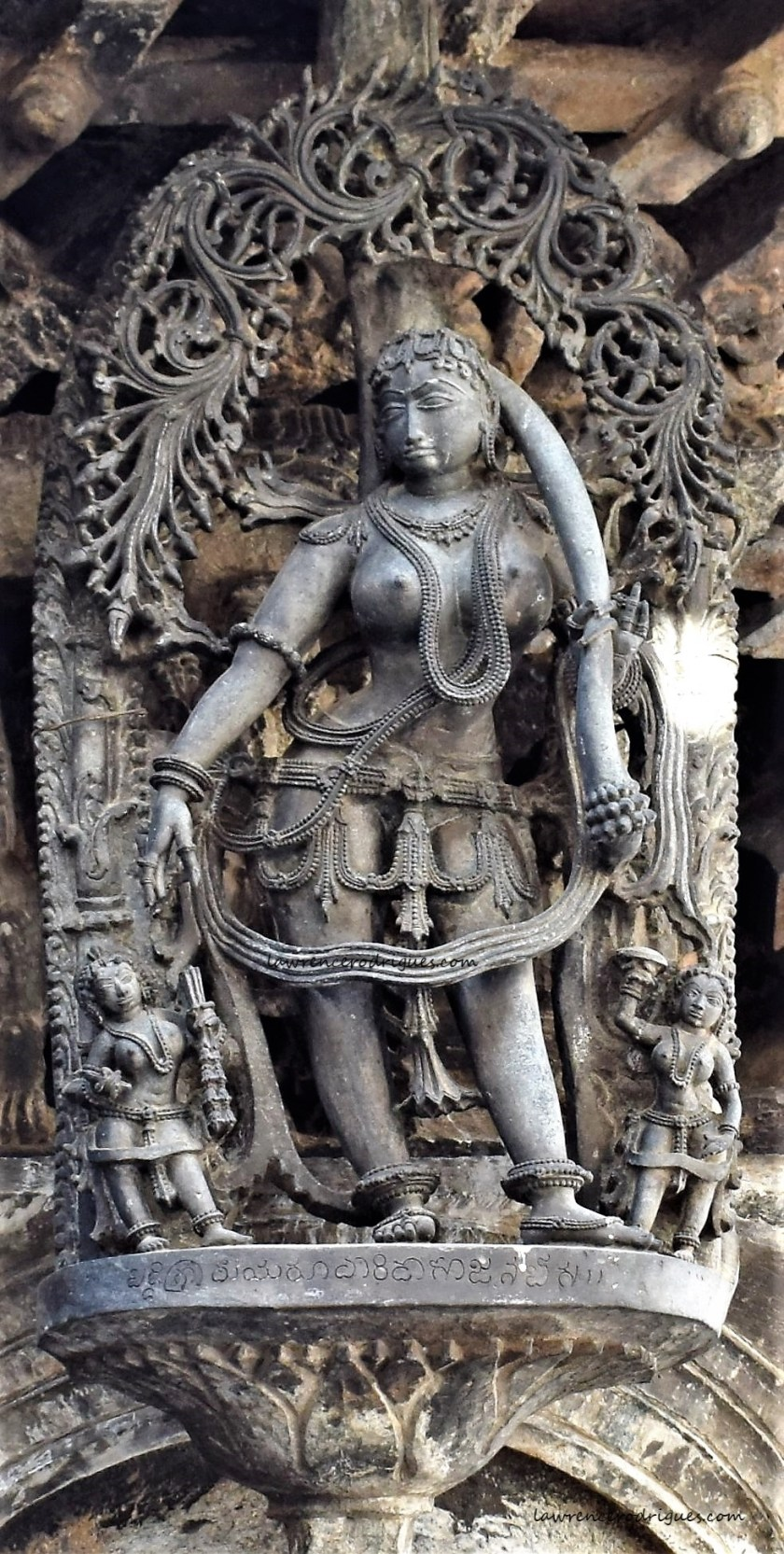 Kesha Sundari - Madanike styling her long hair -A bracket figure mounterd on the exterior wall of the Belur Chennakeshava Temple in Karnataka, India
