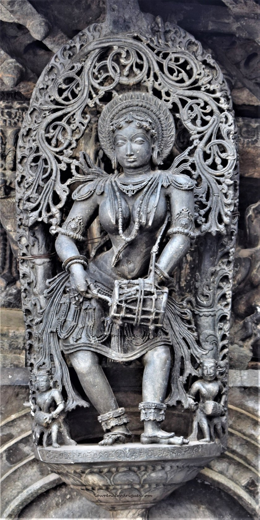 Belur Chennakeshava Temple -Sculpture of a dolu playing dancer mounted on a pillar on the south side