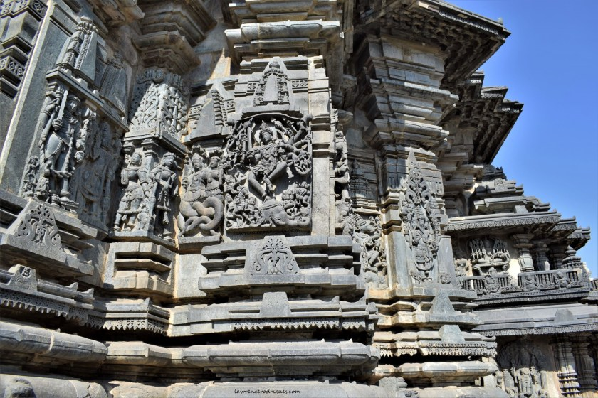 Reliefs on the south-side exterior wall surrounding garbagriha (inner sanctum) of the Belur Chennakeshava Temple in Karnataka, India