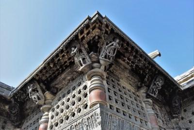 Belur Chennakeshava Temple - Bracket figures mounted on the pillars on the exterior wall surrounding Navaranga