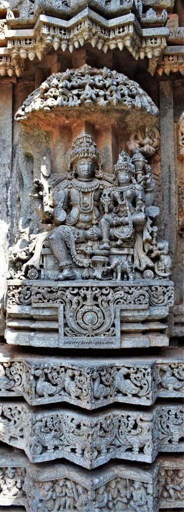 Lakshminarayana - Vishnu with his consort Lakshmi on lap carved on the outer wall of the Somanathapura Keshava Temple in Karnataka, India