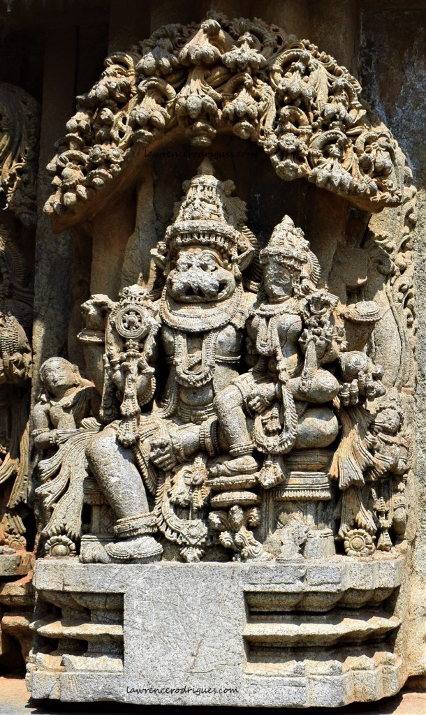 Lakshmi is seated on the lap of Narasimha, the fourth avatar of Vishnu, carved on the outer walls of the Somanathapura Keshava Temple in Karnataka, India