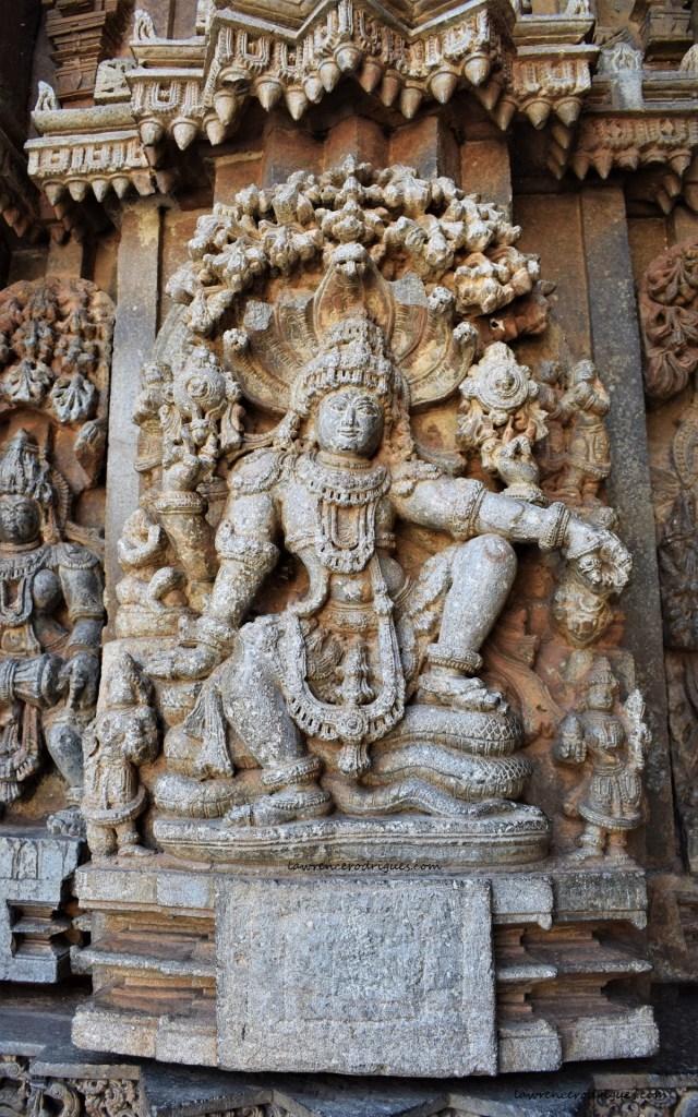 Maha Vishnu seated on Adishesha - A relief carved on the outer wall of the Somanathapura Keshava Temple in Karnataka, India