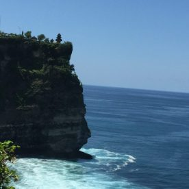 A view of the Uluwatu cliff from the right pathway in Bali, Indonesia