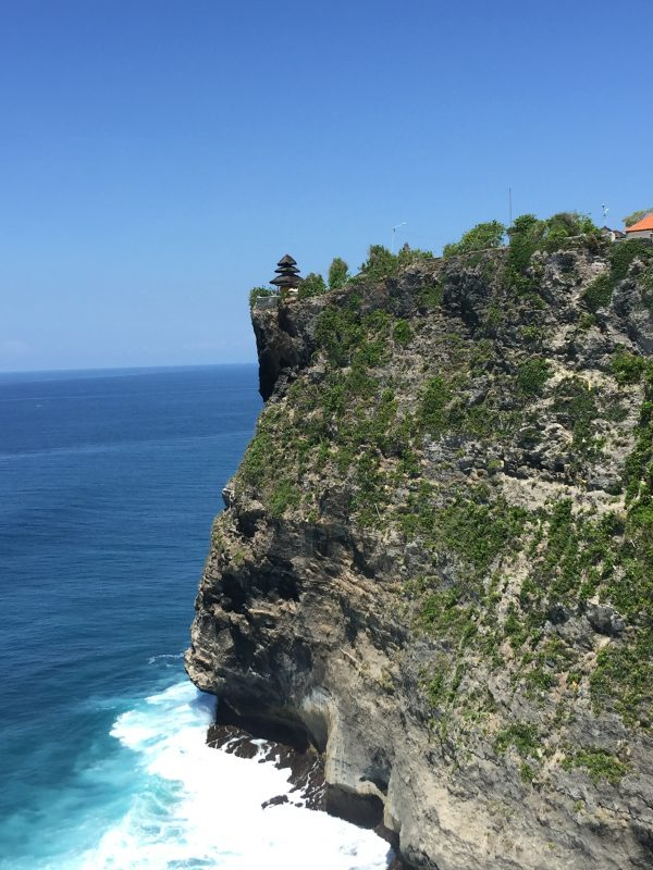 A view of the Uluwatu cliff from the left pathway in Bali, Indonesia