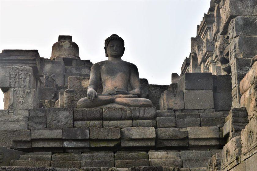 A Dhyani Buddha statue with the Bhumisparsha Mudra gesture at Borbudur in Yogyakarta, Indonesia