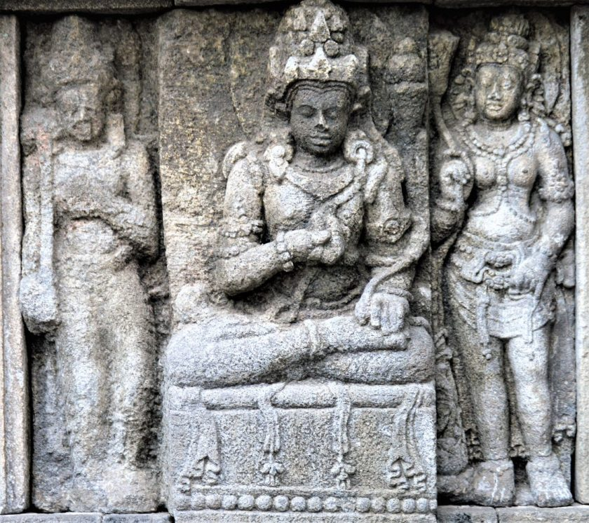 Devata flanked by Apsaras