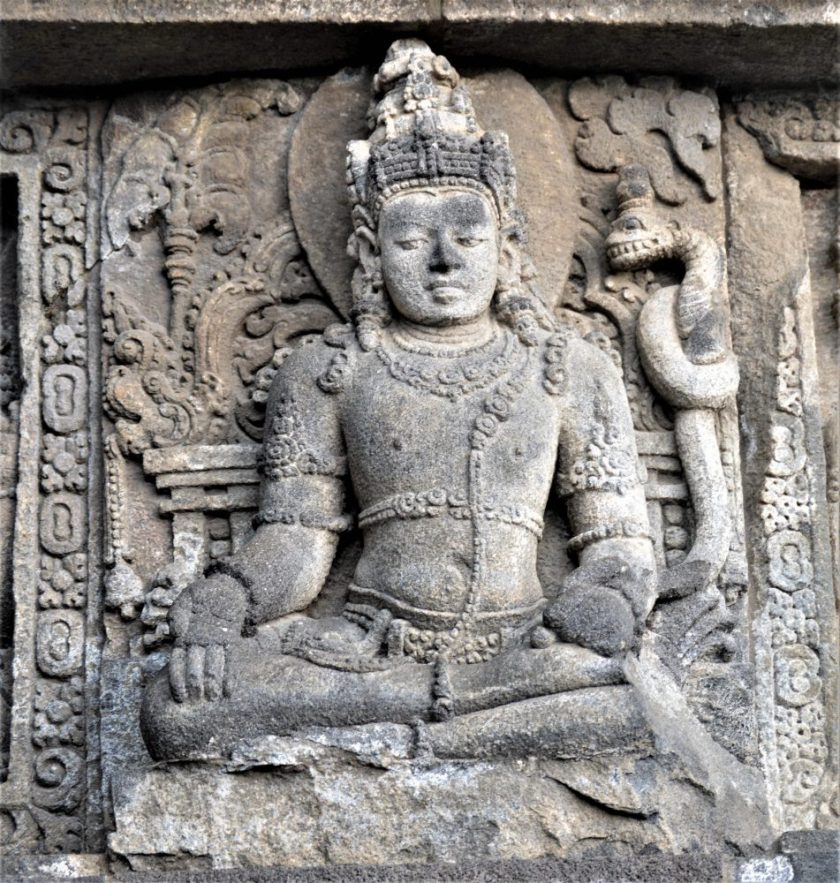 Bas-relief of Lokhapala with the Vara Mudra hand gesture carved in the Shiva Temple in Prambanan, Yogyakarta