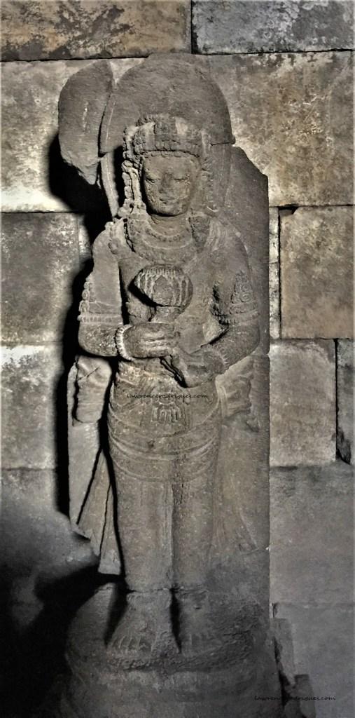 Statue of Dewa Surya (Sun God) standing in the inner chamber of the Nandi Temple in Prambanan, Yogyakarta