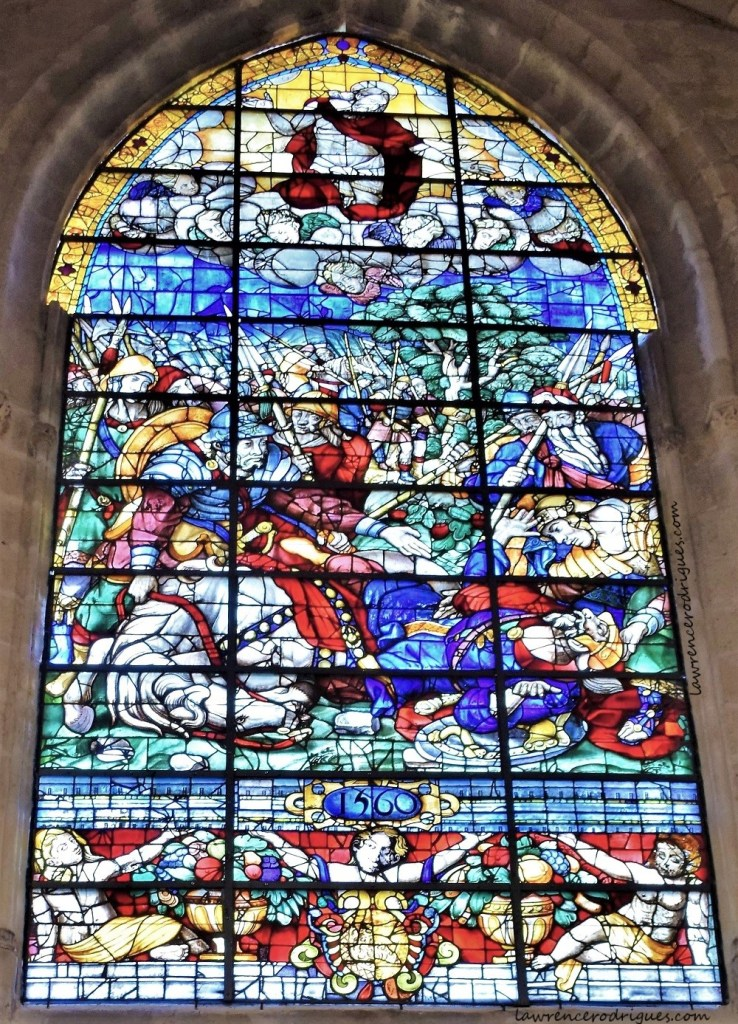 A stained glass window depicting the conversion of St. Paul mounted in the Santiago Chapel in the Seville Cathedral