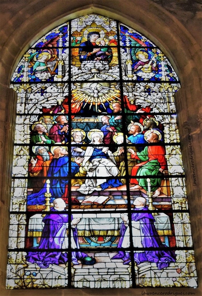 The descent of the Holy Spirit - A stained glass window depicting the descent of the Holy Spirit mounted in the Scalas Chapel in the Seville Cathedral, Spain