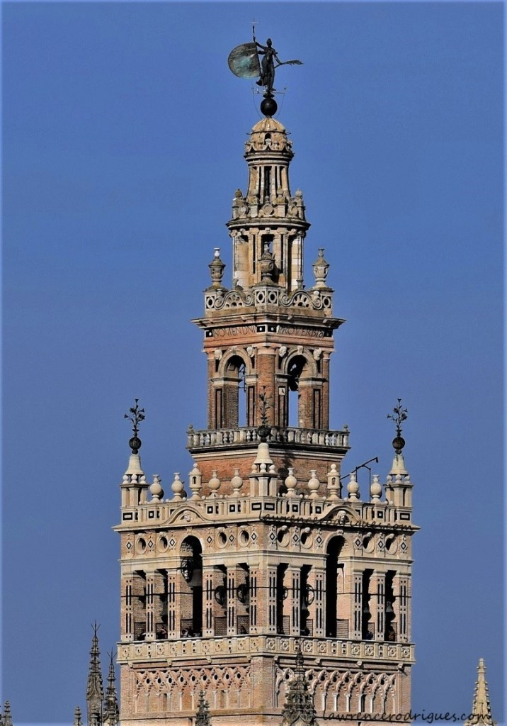 Giralda upper part - Renaissance addition to the Giralda - Belfry and the figure of Faith