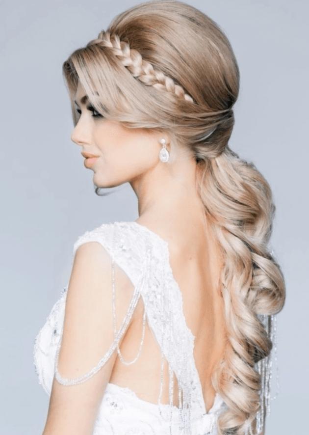 На фото: свадебная прическа - объемная косы на длинных волосах.