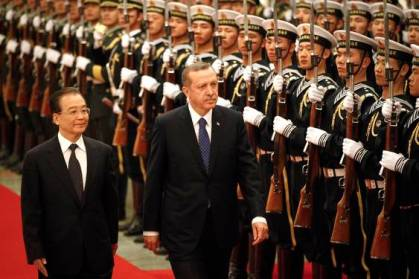 Chinese Premier Wen Jiabao, left, and Turkish Prime Minister Recep Tayyip Erdogan review an honor guard during a welcoming ceremony at the Great Hall of the People in Beijing Monday, April 9, 2012. China acknowledged differences with Turkey over their approach to the continuing violence in Syria, ahead of talks Monday with Turkey's leader, who is making a rare official visit to Beijing. (AP Photo/ Vincent Thian)