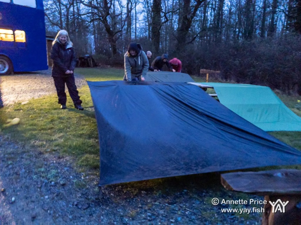 Setting up tarps in the rain..