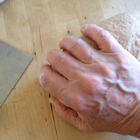 Once more, with my hand on the left side of the dough, I pull and push once more before picking up that left toe end and repeating the steps
