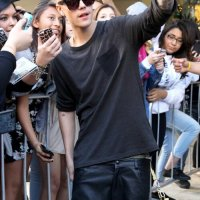 Justin Bieber looking cool with his fans