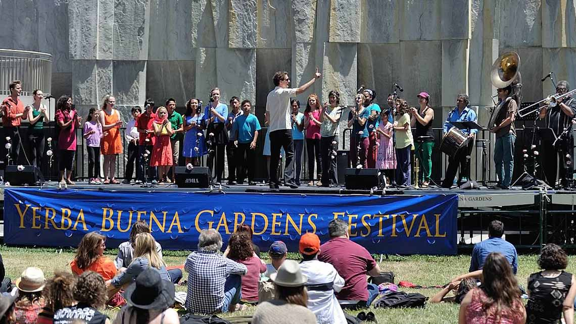 Photo of Darren Johnston & The Trans-Global People's Chorus performing 'Letters to Home'