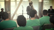 Photo of Marcus Shelby performing for inmates