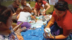 Photo of Kanyon Sayers-Roods crafting with children