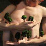 Photo for RAWdance of two people embracing with miniature trees on arms. By Nicholas Terry.