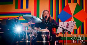 Photo of musician Annete Aguilar playing the drums