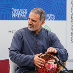 Photo of musician Faisal Zedan playing a hand drum. Photo by www.KelseyOgdenFilmAndPhoto.com