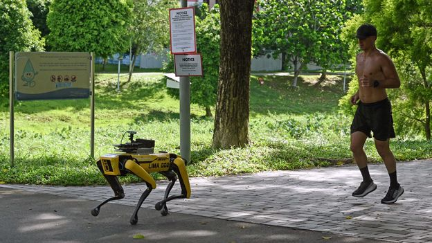 Robot dogs broadcast recorded messages reminding people to observe safe distancing in public spaces (Credit: Credit: Roslan Rahman/Getty Images)
