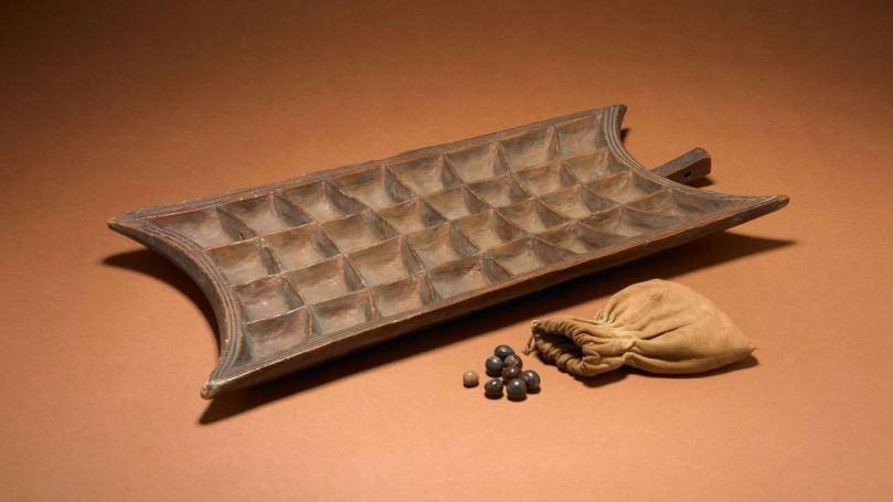 This modern example of a mancala game board comes from Uganda (Credit: The Trustees of the British Museum/ CC BY-NC-SA 4.0)