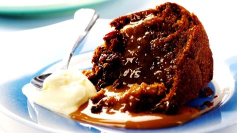 Slice of sticky toffee pudding served with cream