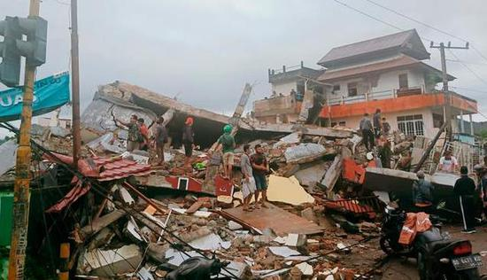 Indonesia's 6.2-magnitude earthquake has killed 26 people, and a local hospital has been razed to the ground.