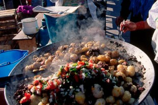 Street Vendors Cook Food at Market