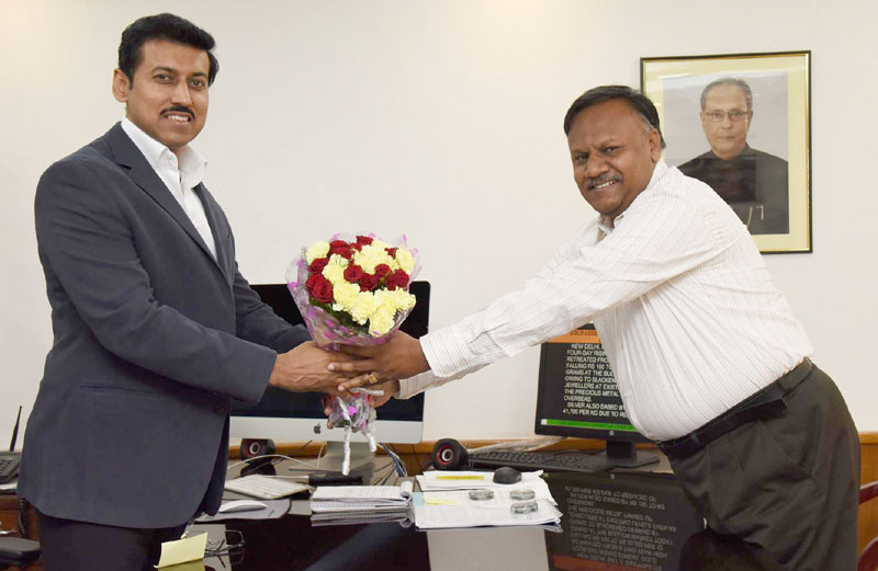 The Minister of State for Information & Broadcasting, Col. Rajyavardhan Singh Rathore greets Mr. Ajay Mittal after taking charge as the Secretary, Ministry of Information & Broadcasting, in New Delhi on May 02, 2016.