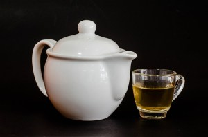[Picture] White tea pot with clear cup of tea